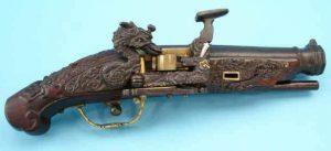 Pistola de pederneira japonesa usando sistema Snaphaunce.